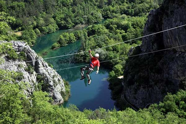 A tourist on the 400-meter-long zip line system which leads to the Toi Cave