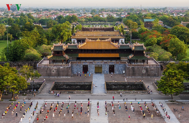 Morning exercises at the imperial city of Hue.